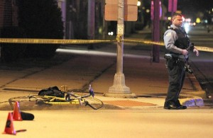 Berwyn police investigate the scene of a serious bicyclist accident at the intersection of 26st., and East Ave., in Berwyn, Monday, Dec. 3, 2012.      (Courtesy of Antonio Perez/Chicago Tribune)