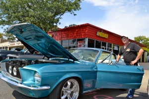 Tom Hanson and his 1967 Ford Mustang with original color and interior.